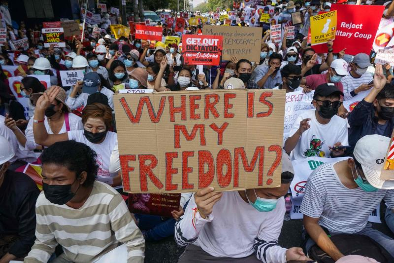 Protesters hold signs as they take part in a demonstration against the military coup in front of the Indonesian embassy in Yangon, Myanmar on Wednesday. (AFP photo)