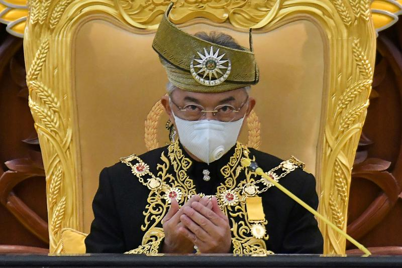 Malaysia's King Sultan Abdullah Sultan Ahmad Shah wears a face mask as he offers prayers during the opening ceremony for the third term of the 14th parliamentary session in Kuala Lumpur, on May 18, 2020. (Photo by NAZRI RAPAAI / Malaysia's Department of Information / AFP)