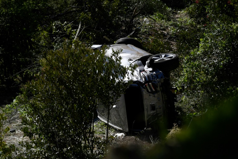 The vehicle driven by Tiger Woods lies on its side in Rancho Palos Verdes, California, on February 23, 2021, after his rollover accident.