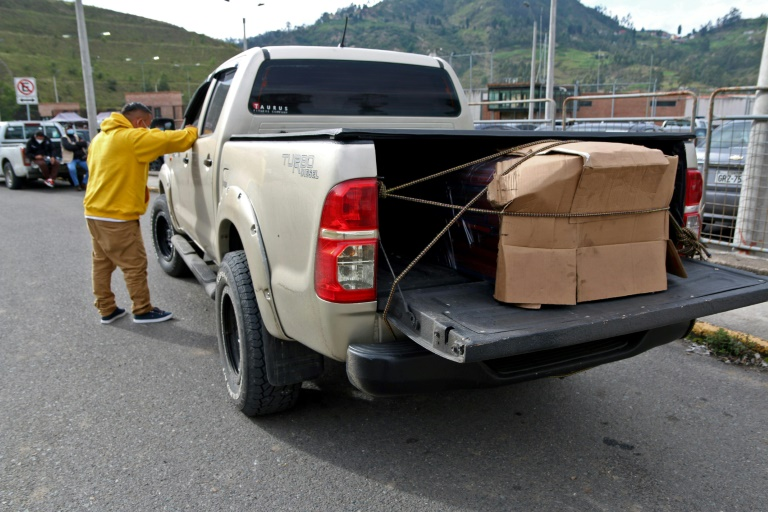 Families claim bodies of inmates as Ecuador prison riot toll climbs