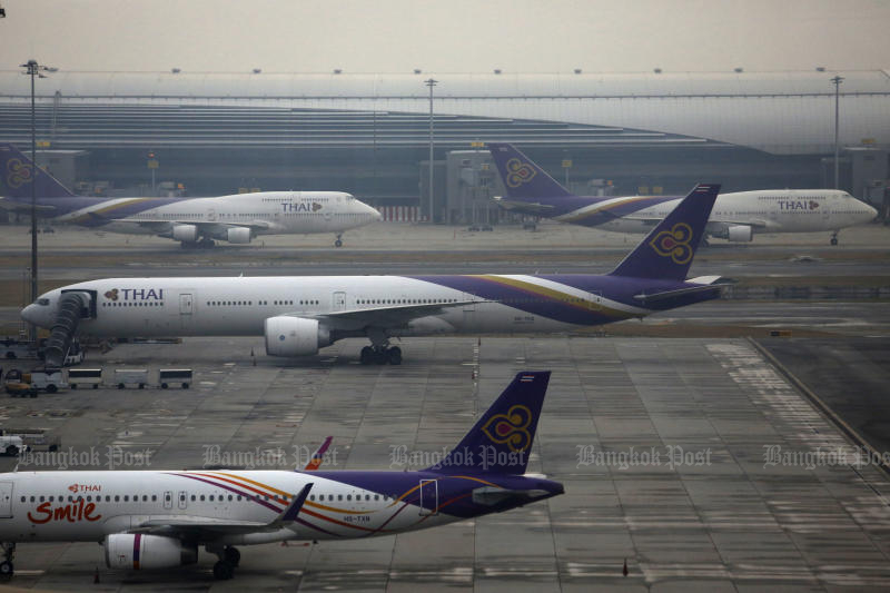 Thai Airways International aircraft are parked at Suvarnabhumi airport after most of the fleet was grounded last year. (Photo by Wichan Charoenkiatpakul)