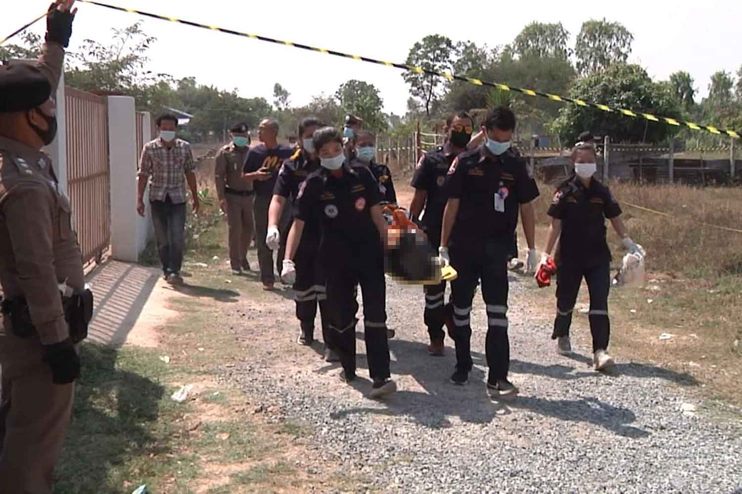 Rescue workers carry off the body of Amornthep Thongchomphu, 22, after his homemade bomb exploded accidentally in a field near his house in Muang district, Khon Kaen, on Friday morning. (Photo: Chakrapan Natanri)