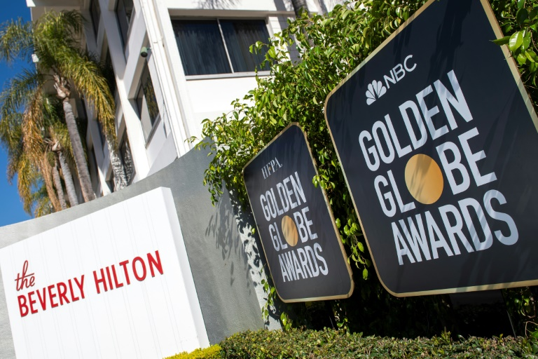 Golden Globes eye history as show goes on without stars