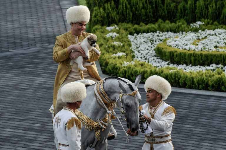 Turkmenistan's President Gurbanguly Berdymukhamedov holds a Turkmen shepherd dog, locally known as alabai