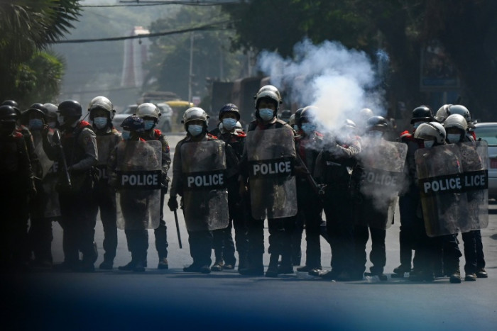 Myanmar police fire rubber bullets as UN envoy breaks ranks