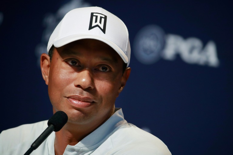 Tiger Woods in 'good spirits' after treatment