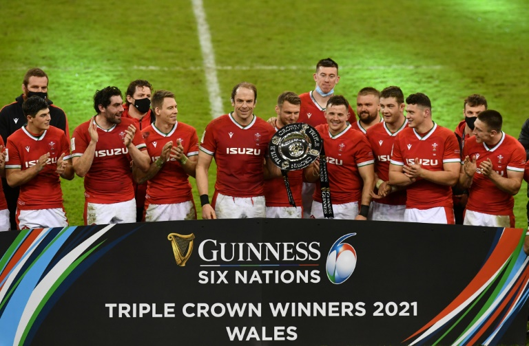 Triple joy - Wales captain Alun Wyn Jones (centre) and fly-half Dan Biggar (centre right) hold the Triple Crown trophy after a 40-24 win over England