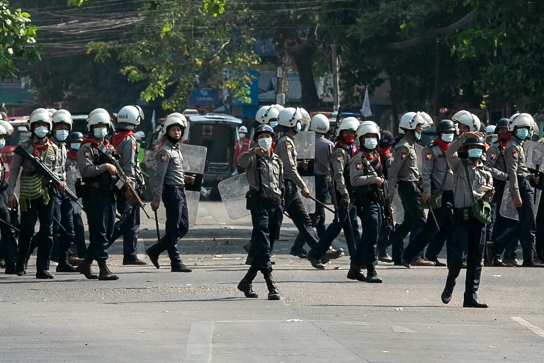 Myanmar police fire stun grenades after journalist arrested overnight