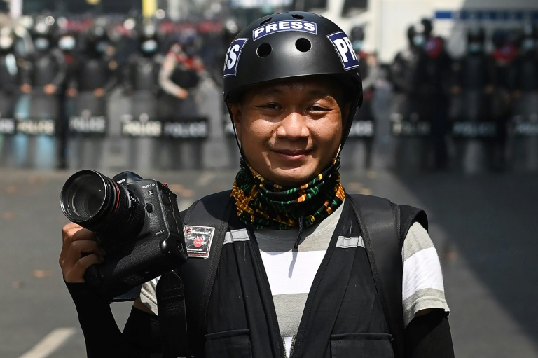 Associated Press (AP) photographer Thein Zaw posing for a photo during his coverage of demonstrations by protesters against the military coup in Yangon, a day before he was arrested.