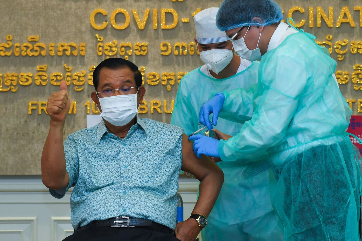 Cambodian Prime Minister Hun Sen gestures as he receives the AstraZeneca vaccine during a vaccination campaign against the Covid-19 coronavirus at Calmette hospital in Phnom Penh on Thursday. (AFP photo)