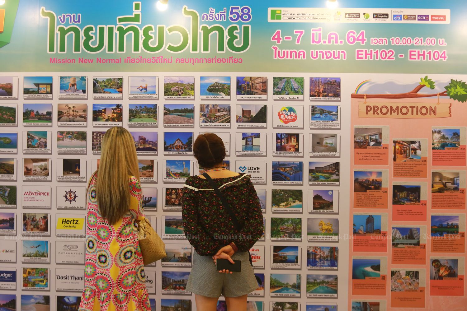 Visitors check tour packages at a travel fair promoting domestic tourism at Bitec Bang Na on Thursday. (Photo by Somchai Poomlard)