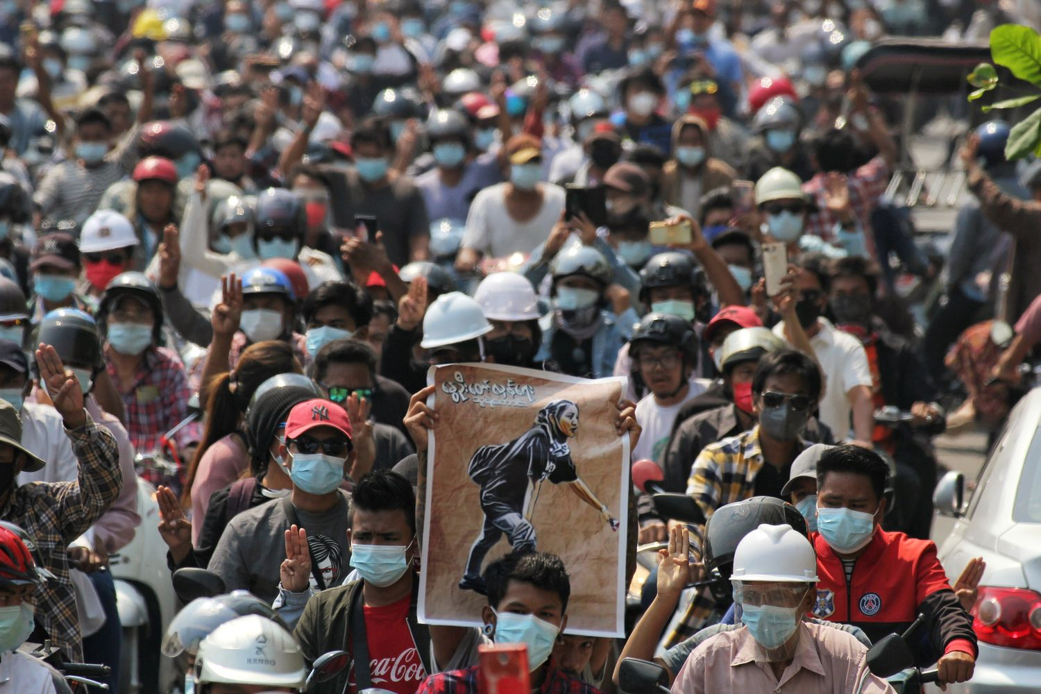 People attend the funeral of Angel a 19-year-old protester also known as Kyal Sin who was shot in the head as Myanmar forces opened fire to disperse an anti-coup demonstration in Mandalay, Myanmar, on Thursday. (Reuters photo)
