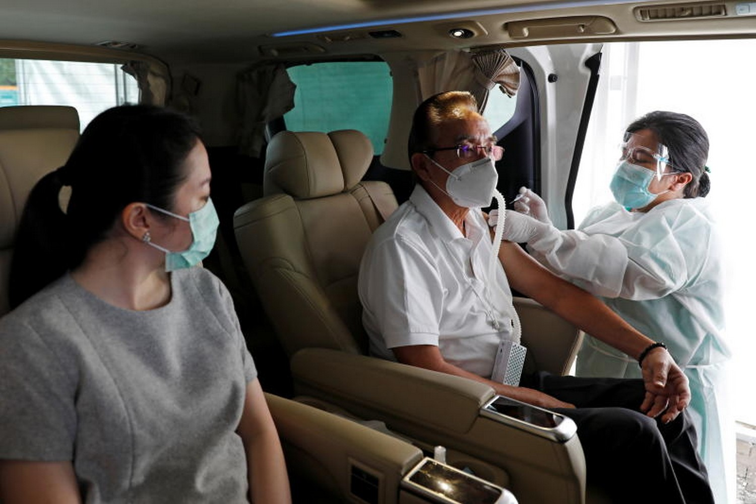 A man wearing a protective mask receives a dose of China's Sinovac Biotech vaccine for the coronavirus disease at a drive-through vaccination station on Friday, part of a mass vaccination program for elderly people, in Jakarta, Indonesia. (Photo: Reuters)