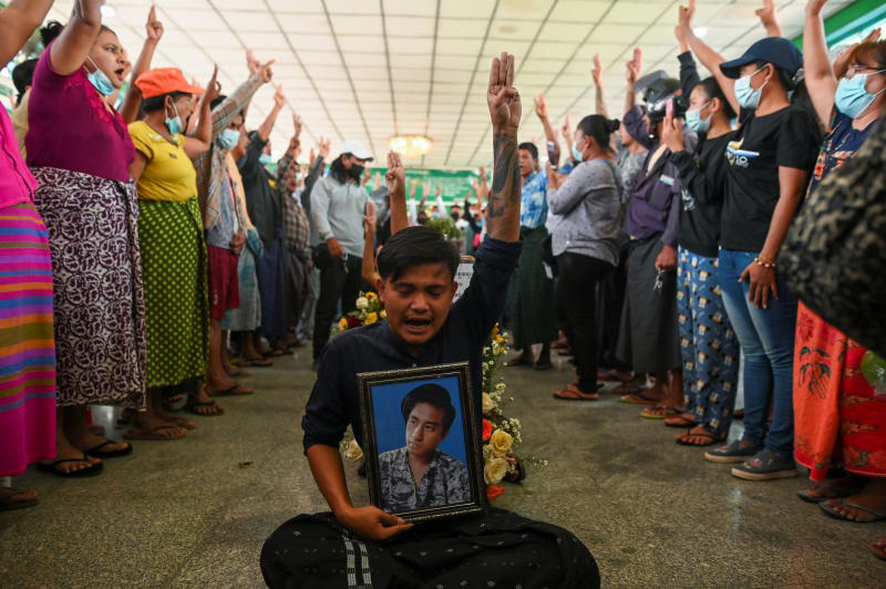 People flash a three-finger salute as they attend the funeral of victims shot dead during the anti-coup protest in Yangon. Another man was killed during a rally in Mandalay on Friday. (Photo: Reuters)