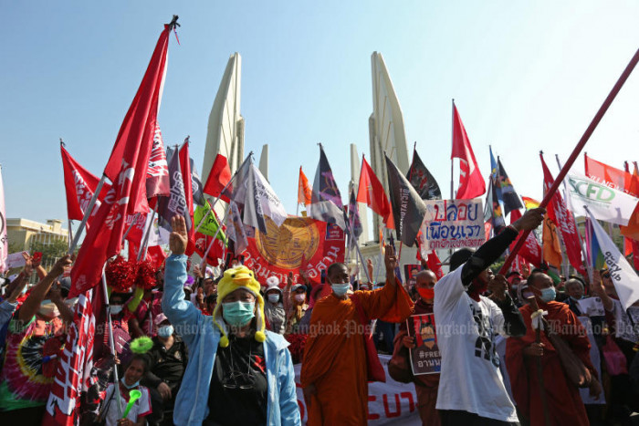 Marchers shrug off police warning, rally at Democracy Monument