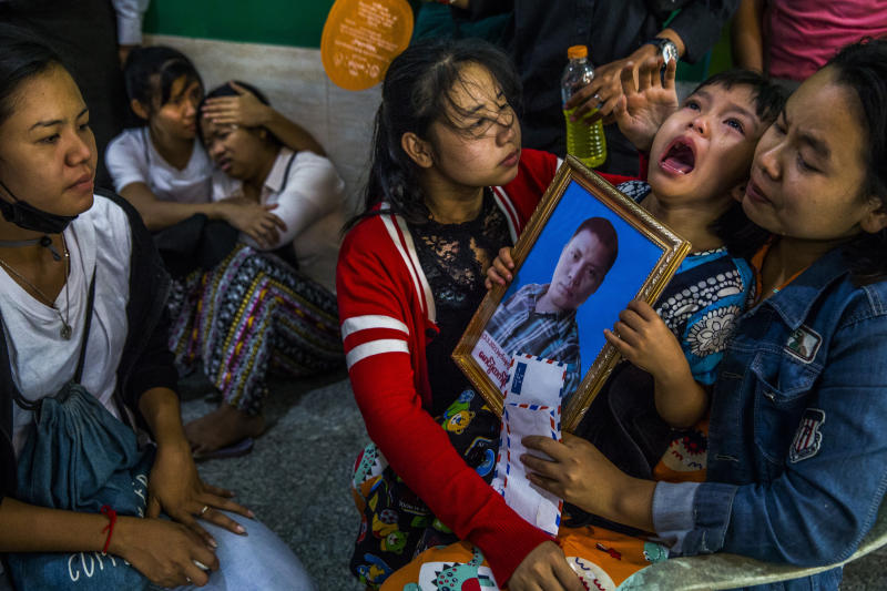Shwe Yote Hlwar, 5, holds a portrait of her father, Zwe Htet Soe, 26, who was shot and killed while protesting, during his funeral in Yangon, Myanmar, March 5, 2021. The military and its brutal practices are an omnipresent fear in Myanmar, one that has intensified since the generals seized full power in a coup last month. (Photos: The New York Times)