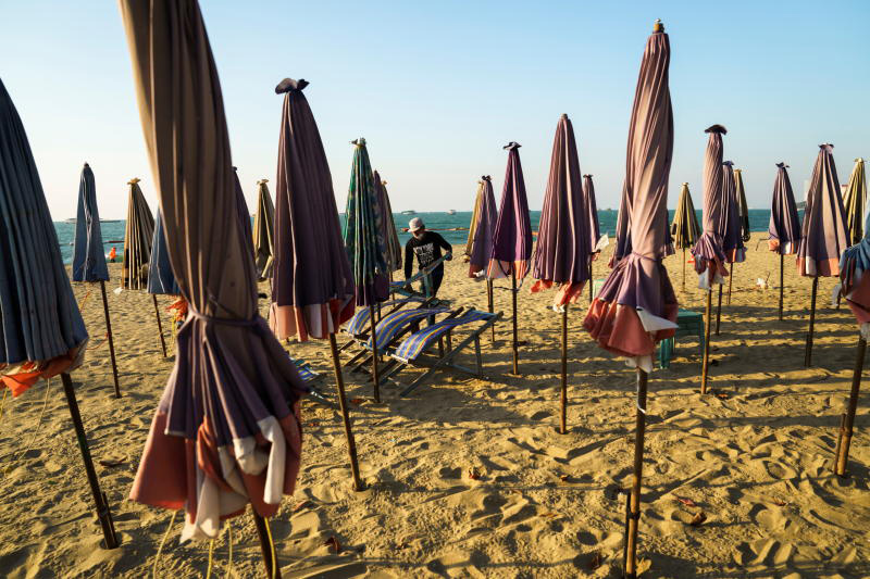 A man collects his chairs on an almost empty beach amid fears of the coronavirus disease outbreak in Pattaya on Jan 12, 2021. (Reuters file photo)
