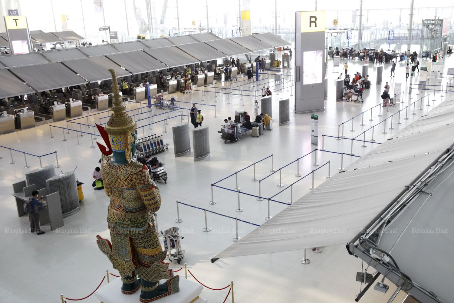 A view inside Suvarnabhumi airport in March. The number of foreign travellers arriving in Thailand has fallen by half since the virus outbreak. (Photo by Wichan Charoenkiatpakul)