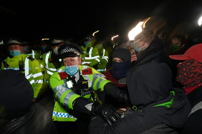 Police officers scuffled with some members of the hundreds-strong crowd that gathered in the evening despite coronavirus restrictions for a candlelit tribute.