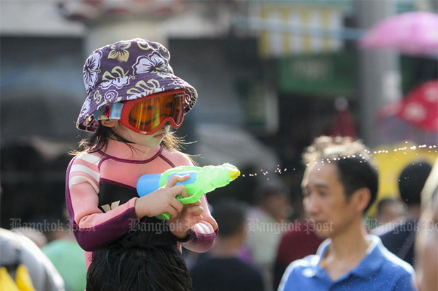 A girl shoots her water gun at revellers during the Songkran festival in Phra Pradaeng district, Samut Prakan, on April 21, 2019. Water fights are banned during the celebration this year, as they were last year. (File photo)