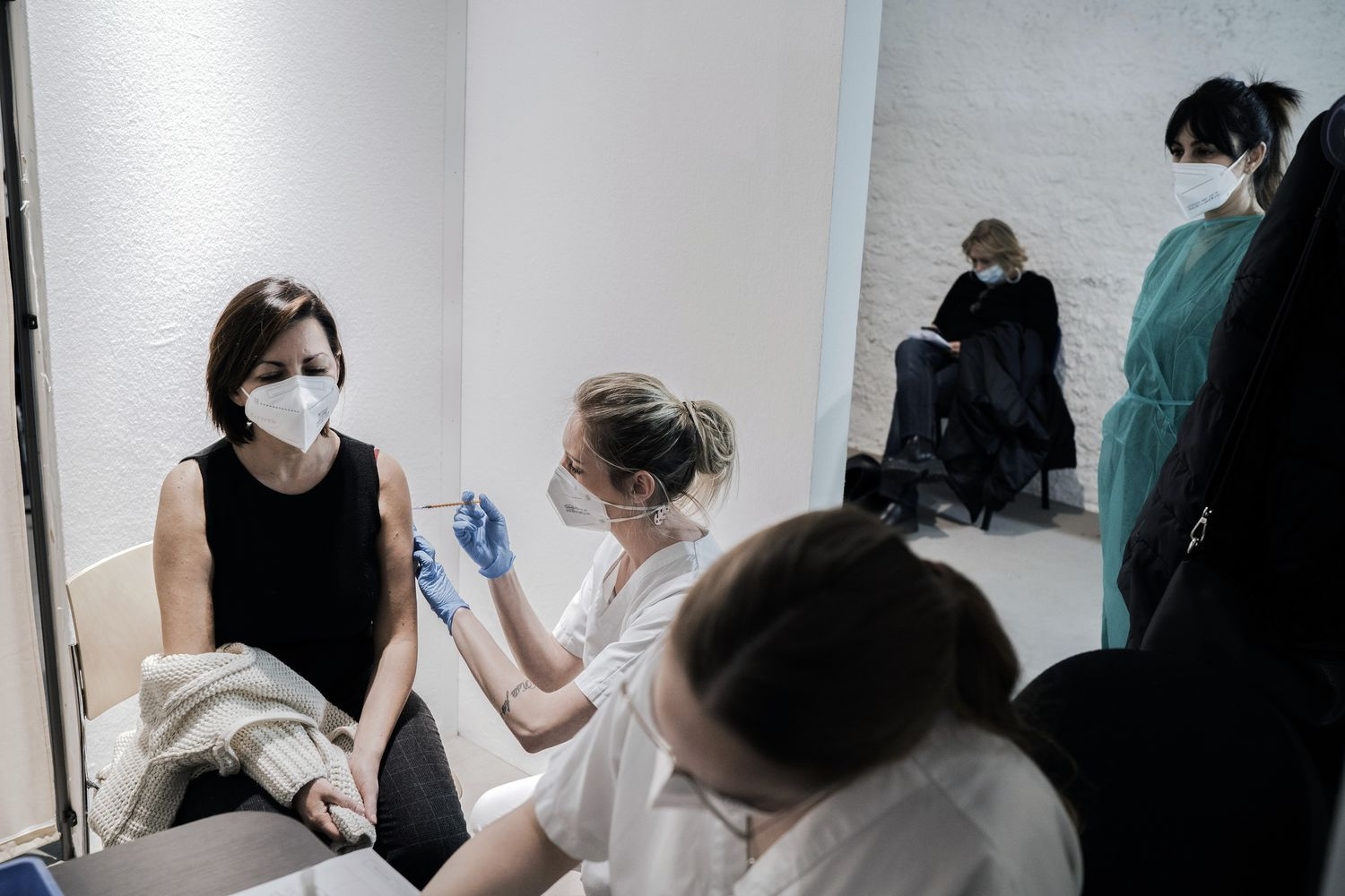 A woman receives an AstraZeneca Covid-19 vaccine at the Museum of Science and Technology in Milan on Monday. (Alessandro Grassani/The New York Times)