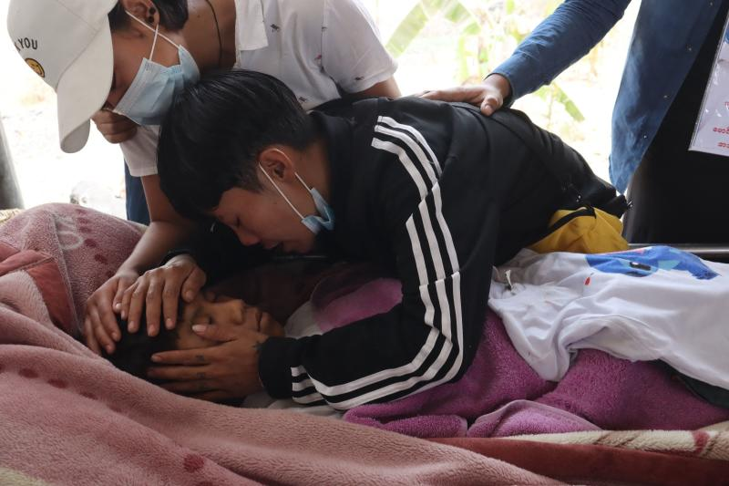 Family members grieve over the body of teenage bystander Tun Tun Aung at a cemetery in Mandalay on Tuesday, a day after he was shot dead in front of his home by security forces during a crackdown on demonstrations against the military coup. (AFP photo)