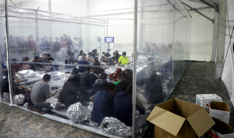 Migrants crowd a temporary processing center in Donna Texas
