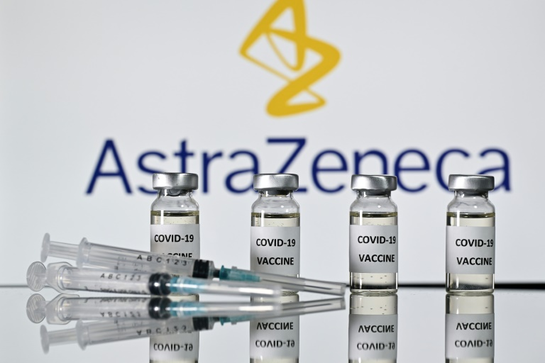Vials with Covid-19 Vaccine stickers attached and syringes with the logo of British pharmaceutical company AstraZeneca.
