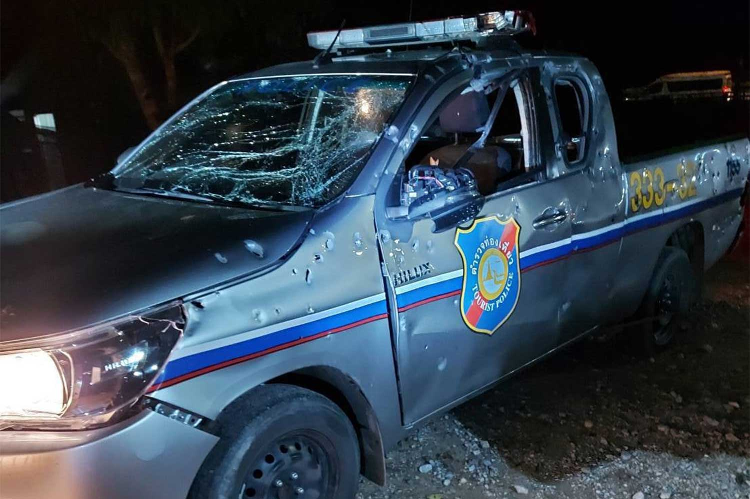 The tourist police vehicle damaged by a roadside bomb in Bannang Sata district, Yala, on Thursday night. A tourist policeman and a police volunteer were wounded.(Photo: @maeluang318133, Maeluang Pattani Centre Facebook page)