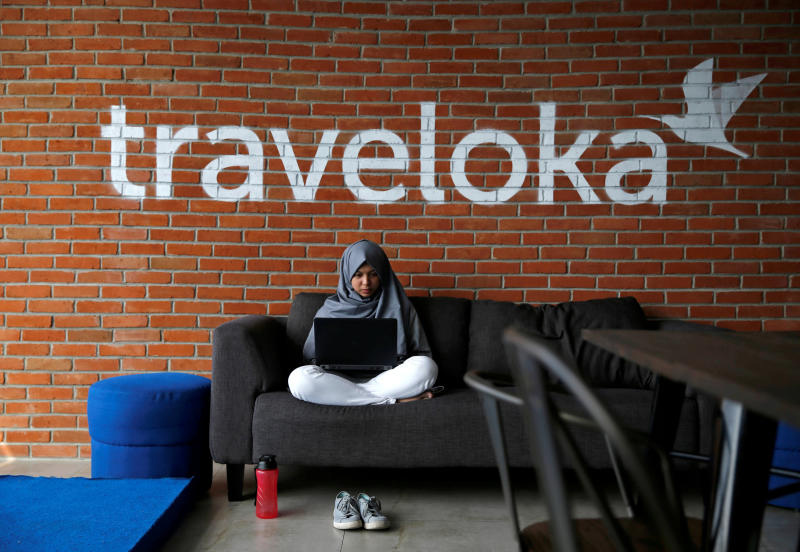 An employee of Traveloka works at the company's headquarters in Jakarta. (Reuters photo)