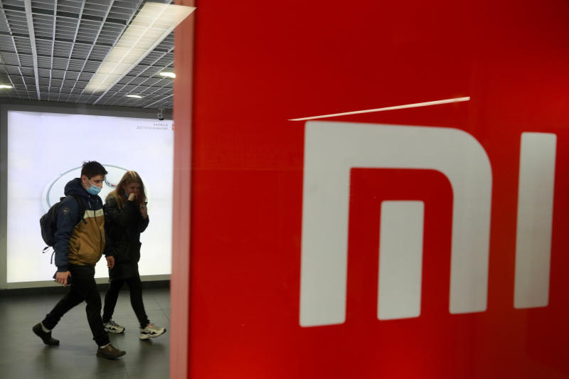 People wearing protective face masks visit Xiaomi brand's store in Kyiv, Ukraine October 22, 2020. (Reuters file photo)