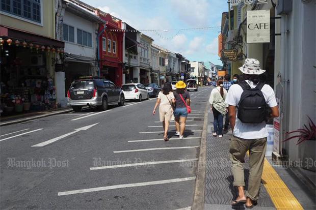 Local tourists walk through the old quarter of Phuket on Sept 14, 2020. (Photo by Dusida Worrachaddejchai)
