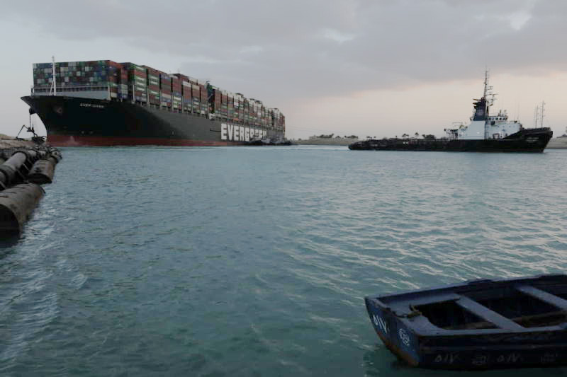 The stranded Ever Given, one of the world's largest container ships, is seen on Sunday after it ran aground in Suez Canal, Egypt. (Suez Canal Authority via Reuters photo)