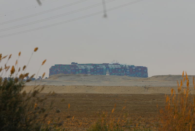 A view shows the stranded container ship Ever Given, one of the world's largest container ships, after it ran aground, in Suez Canal, Egypt on Sunday. (Reuters photo)