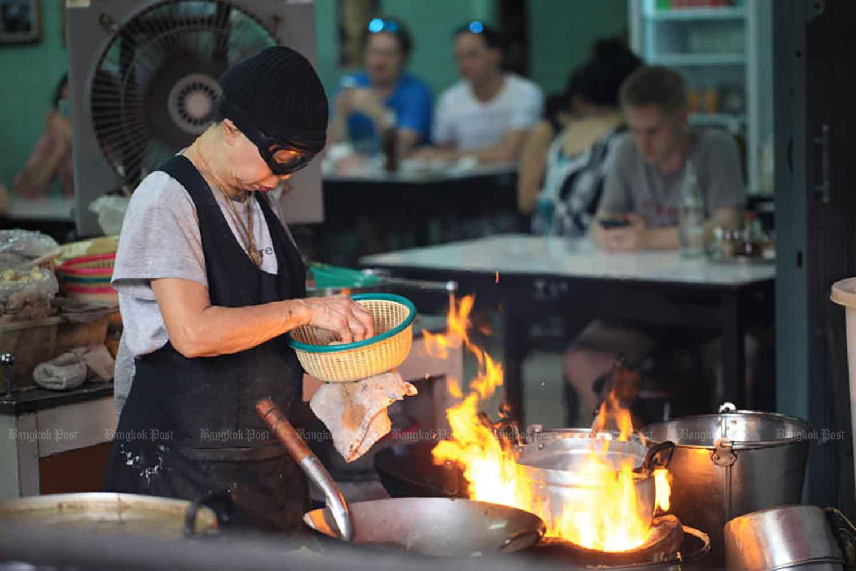 Jay Fai, or Supinya Junsuta, wears her trademark ski goggles as she cooks.
