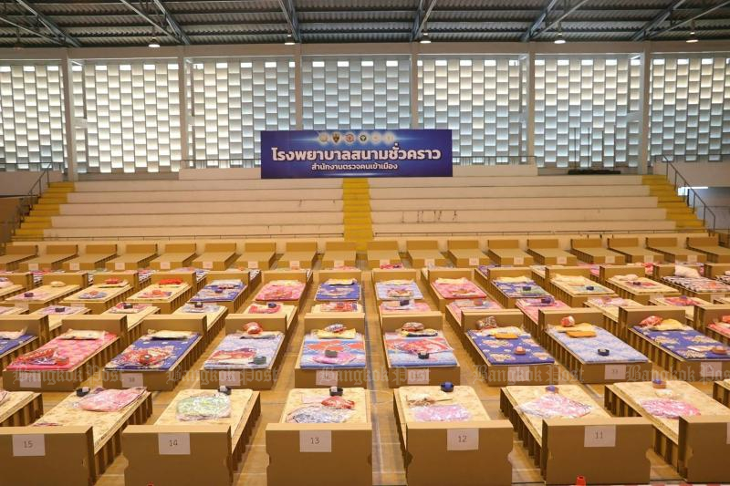 Beds for immigration detainees at a field hospital in Bangkok following an outbreak of Covid-19 in late March. (AFP photo / Thai Immigration Police)