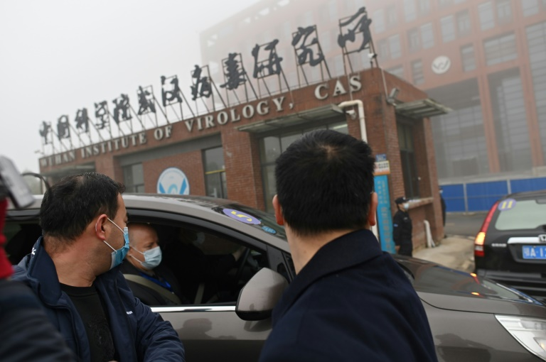 Members of the World Health Organization (WHO) team investigating the origins of the Covid-19 coronavirus visit the Wuhan Institute of Virology in Wuhan on Feb 3, 2021