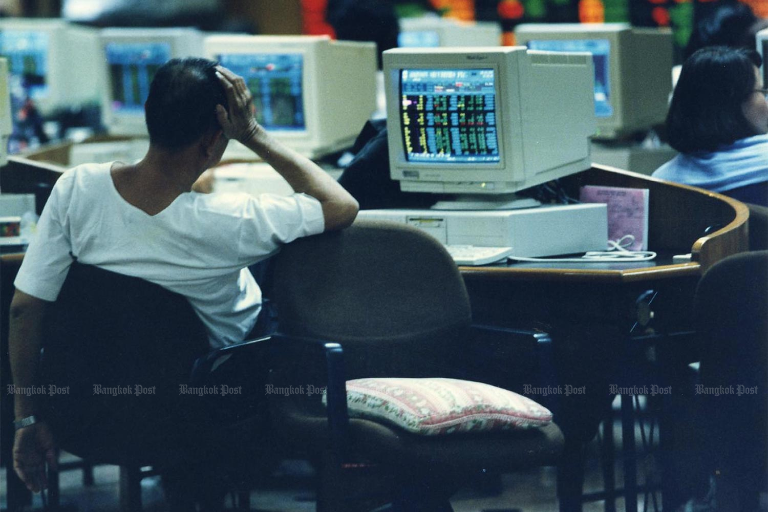 In this 1997 file photo, an investor reacts to market news as a number of finance companies closed down during the economic crisis. (Bangkok Post photo)