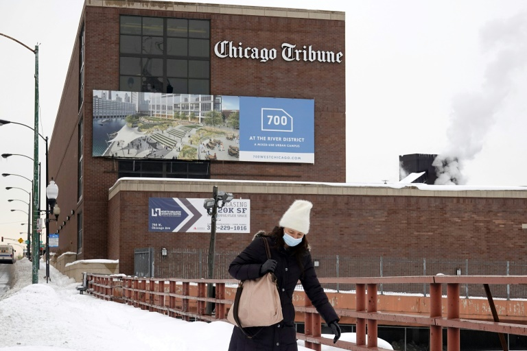 The Chicago Tribune, whose headquarters is seen here, is the flagship of the Tribune Publishing chain which is the object of a bidding war between a hedge fund and a civic-minded billionaire.