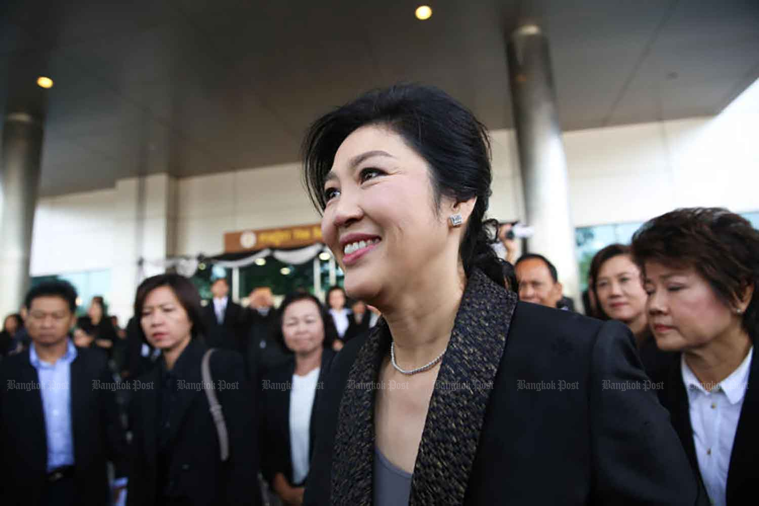 Former prime minister Yingluck Shinawatra appears at the Supreme Court's Criminal Division for People Holding Political Positions in Bangkok on Aug 1, 2017, to deliver her closing statement in the case involving her administration's corruption-ridden rice-pledging scheme. She fled the country later in the same month. (File photo)