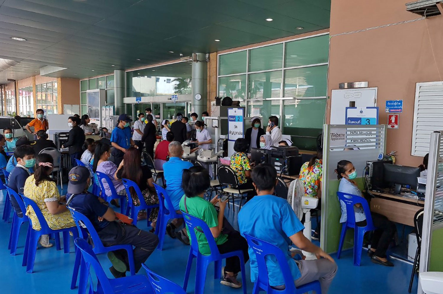 People wait their turn for Covid-19 vaccination at Pattaya City Hospital on Friday. (Photo: Chaiyot Pupattanapong)