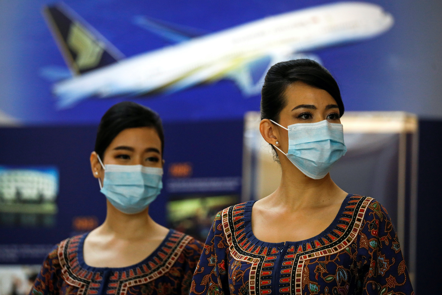 Cabin crew wait for participants during a guided tour at the Singapore Airlines Training Centre in Singapore in November. (Reuters Photo)