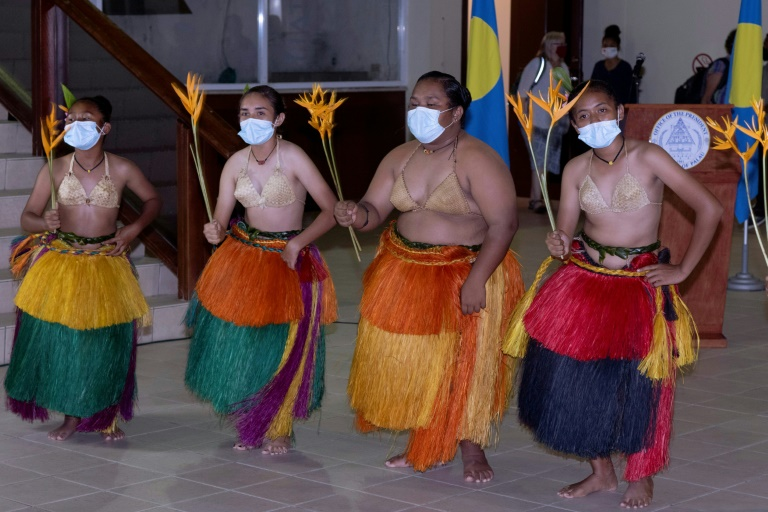 Traditional Palau dancers greeted the first group of tourists from Taiwan.
