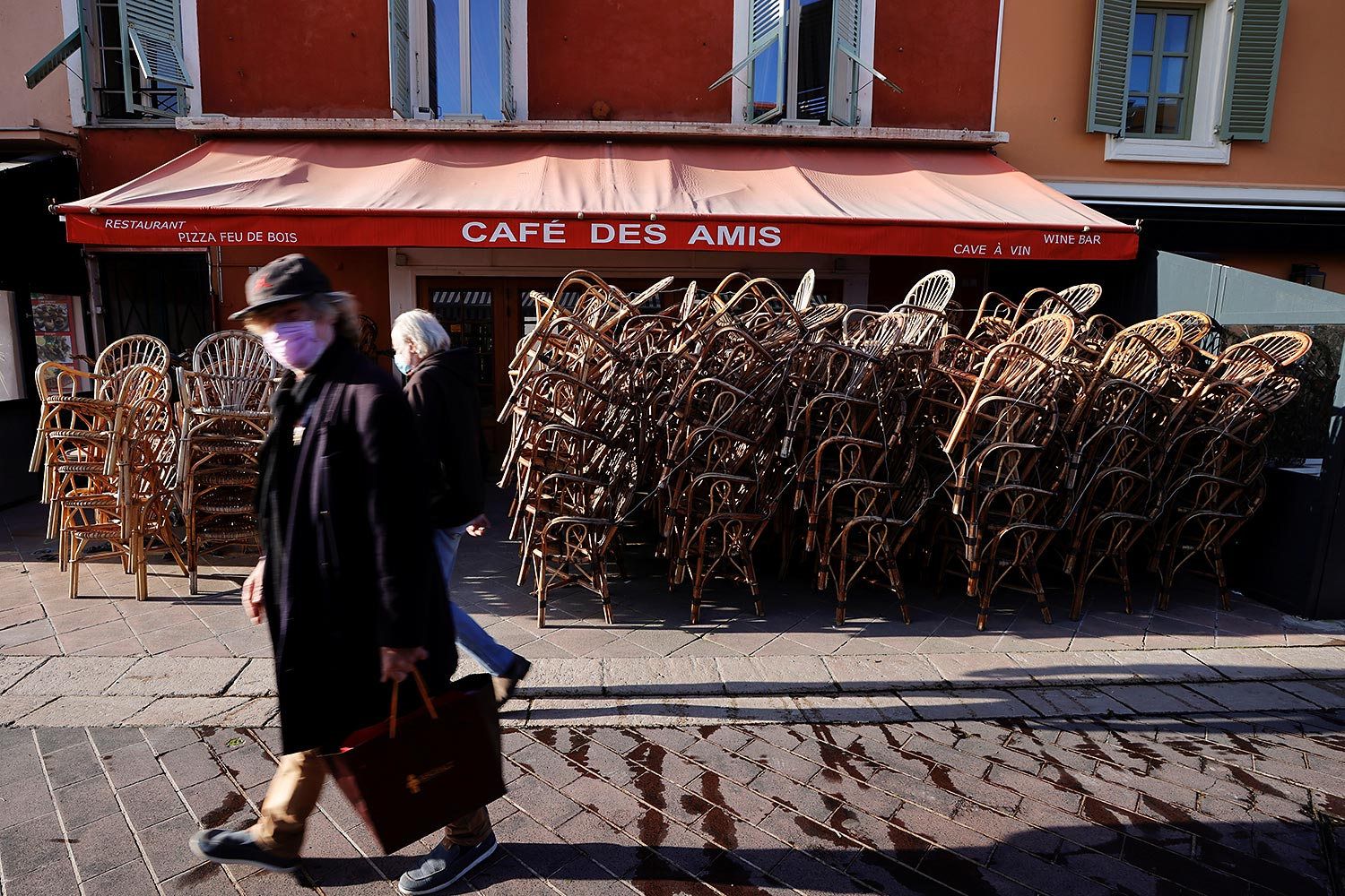 People walk past a closed restaurant during the third lockdown imposed to slow the rate of the coronavirus disease contagion, in Nice, France on Thursday. (Photo: Reuters)