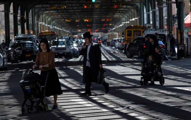 Members of New York's Orthodox Jewish community walking in Brooklyn ahead of last week's Passover celebrations