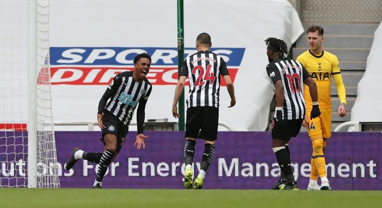 Newcastle midfielder Joe Willock (left) celebrates scoring against Tottenham.