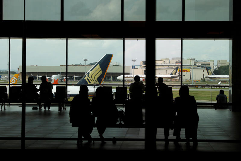 People look at a Singapore Airlines plane, amid the spread of the coronavirus disease , at a viewing gallery of Changi Airport in Singapore. (Reuters file photo)