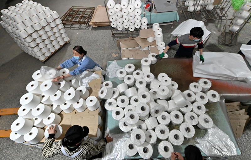 Workers are seen on the production line at a cotton textile factory in Korla, Xinjiang Uighur Autonomous Region, China April 1, 2021. (Reuters photo)