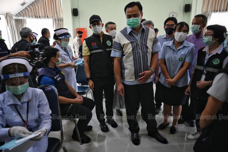 FILE PHOTO: Deputy Prime Minister and Health Minister Anutin Charnvirakul watches nurses administer the Coronavac vaccine to frontline health workers at Mae Sariang Hospital in Mae Hong Son province on April 2, 2021. (AFP)