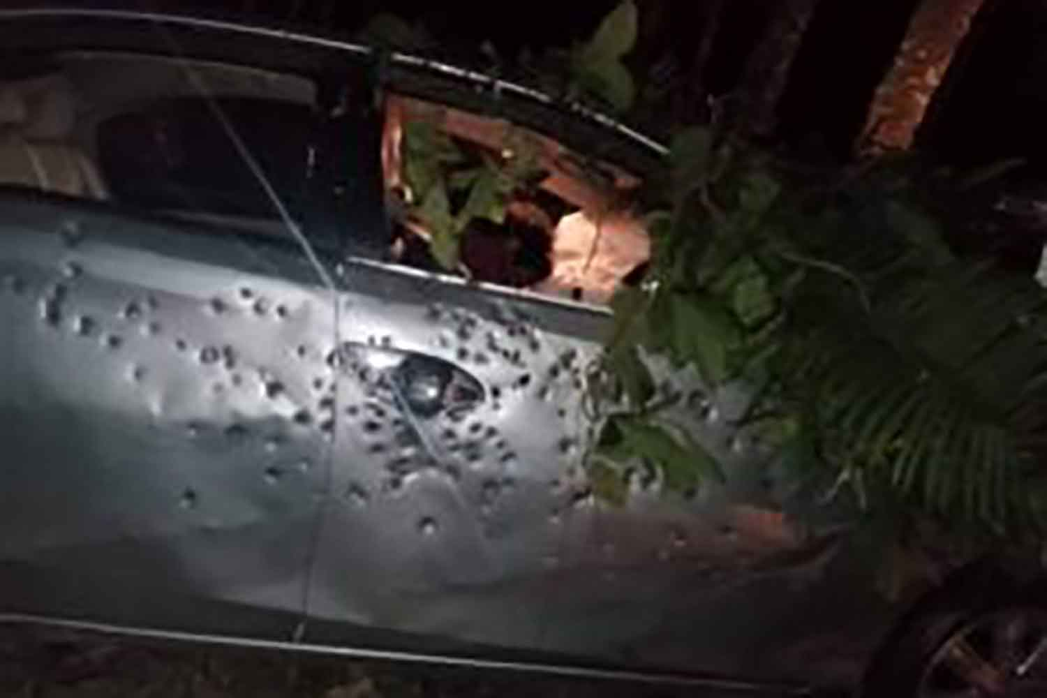 The bullet-riddled car in which a muslim cleric was found dead after a clash between insurgents and police in Pattani's Khok Pho district on Tuesday night.(Photo: Abdullah Benjakat)
